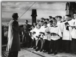 William Shenton, choirmaster, directs the choir at the tower top - Click to Enlarge