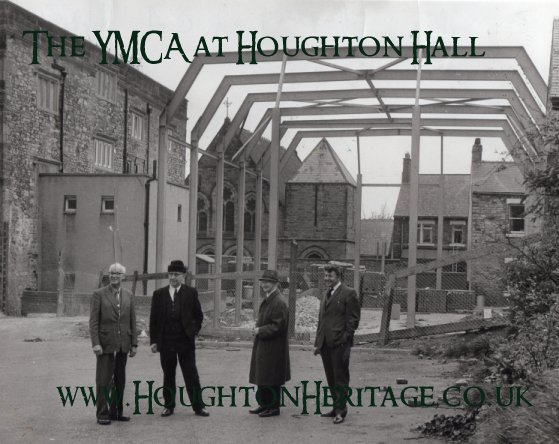 The rear of Houghton Hall, circa 1972, showing the construction of the John Edwards Sports Hall (named after the local chairman responsible for the restoration). During the construction a Tudor arch was uncovered